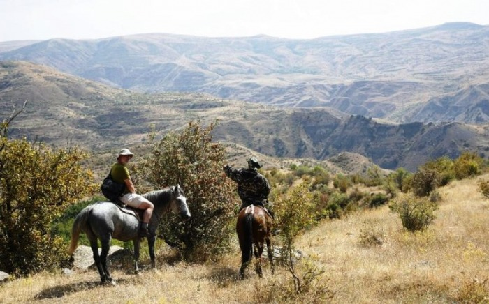 Horse back riders in Khrosov Forest Reserve Armenia