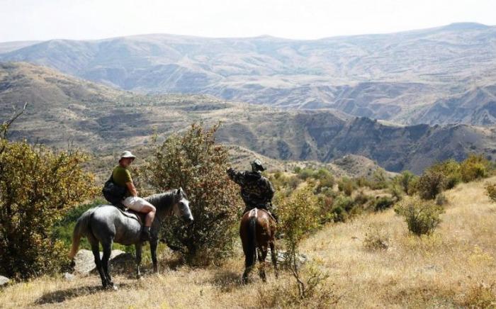Horse back riders in Khrosov Forest Reserve Armenia