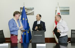 Geof Giacomini (CNF), Minister Davitashvili and Valerian Mchedlidze (APA) just after signing agreement.