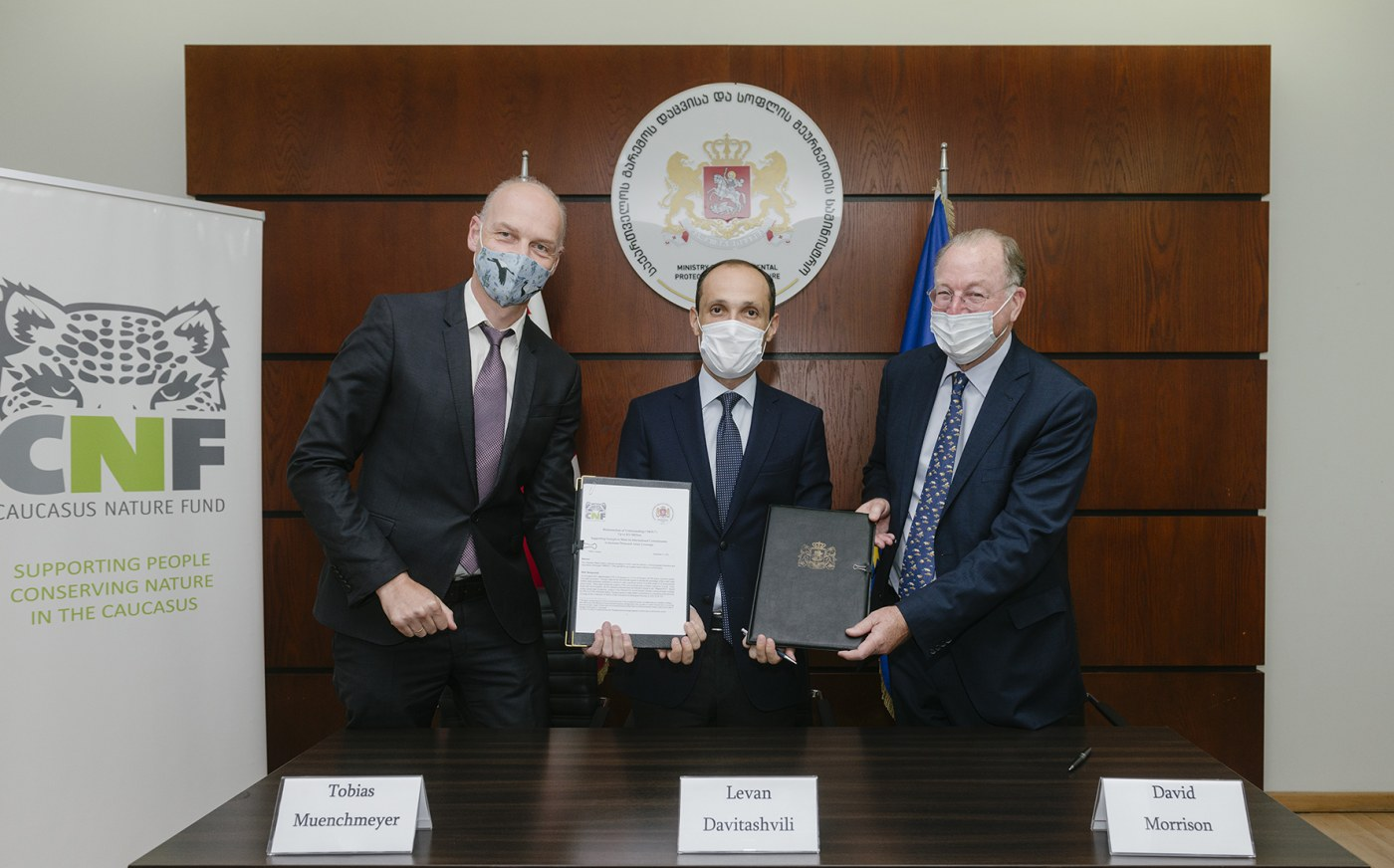 Signing Ceremony with Vice Premier of Georgia Levan Davitashvili (mid), CNF's Supervisory Board Chair David Morrison (right), Executive DIrector of CNF Tobias Muenchmeyer (left)